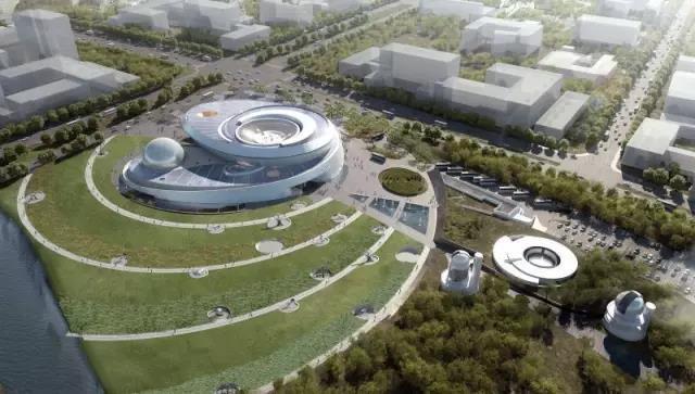 """上海天文馆的主体建筑设计体现了""""天体""""及""""轨道运动""""的概念,其主展区"""